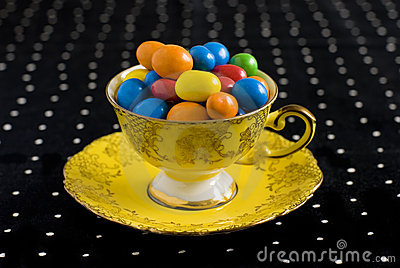 Colourful sweets in vintage teacup