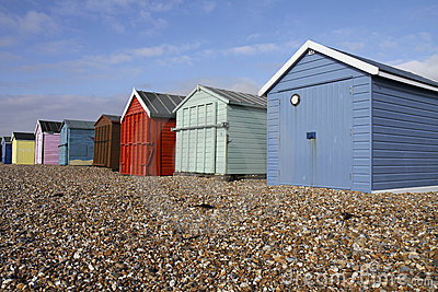 Colourful wooden beach huts on a sunny day on Hayl
