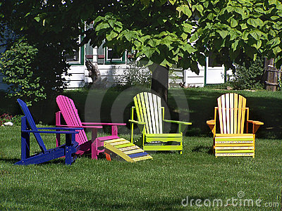 Colourful wooden lawn chairs
