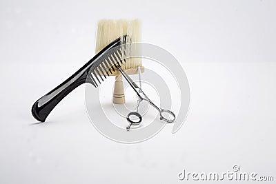 Comb, scissors and brush
