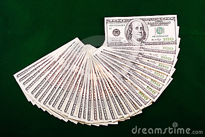 A combination of dollar fan over a green backgroun