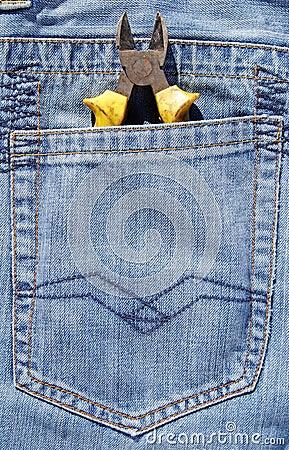 Combination pliers in jeans pocket