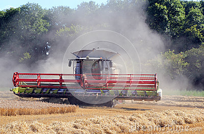 Combine harvester in the dust.