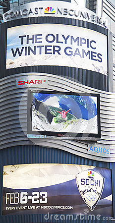 Comcast NBC Universal billboard decorated with Sochi 2014 XXII Olympic Winter Games logo near Times Square Editorial Stock Photo