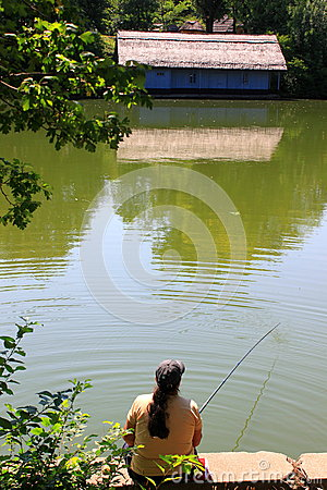 Woman fishing on the lake Editorial Stock Image