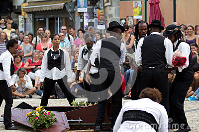 Comedians near a coffin Editorial Stock Image