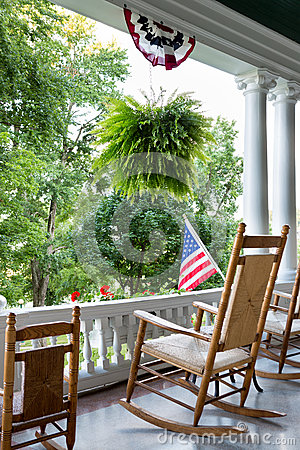 Free Comfortable Wooden Rocking Chair To Enjoy 4th July Royalty Free Stock Images - 51549619