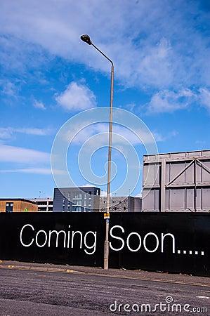 Coming soon billboard on a city road