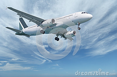 Commercial aircraft in sky