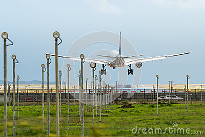 Commercial jet airliner landing at airport