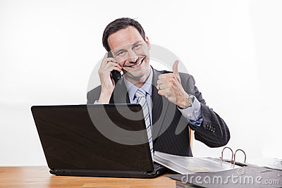Committed employee smiling at phone thumbs up