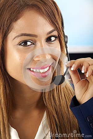 Communication: Woman talking on a headset