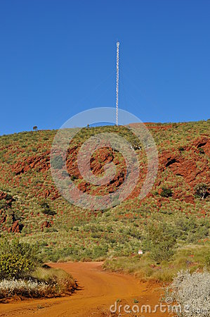 Communications tower in Australian outback with ro
