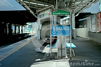 Commuter On Bench At Train Station Free Public Domain Cc0 Image
