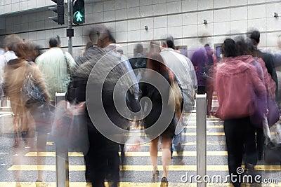 Commuters Crossing Busy Hong Kong Street