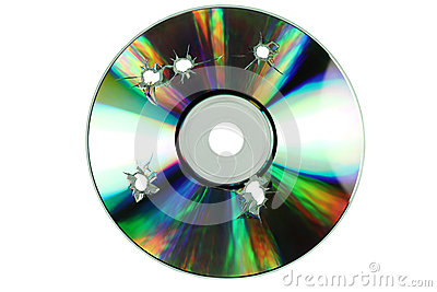 Compact disc with the holes of the shots