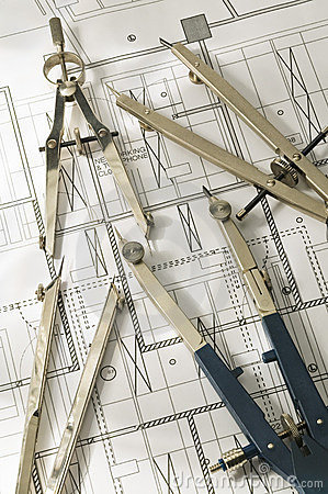 Compass and dividers against a blueprint