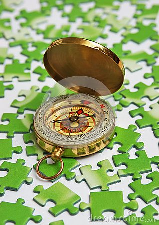 Compass on green puzzle