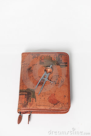 Compass on a leather travel journal.