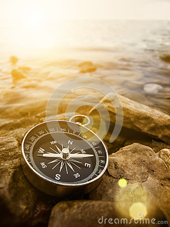 Free Compass On The Shore At Sunrise Stock Photography - 36712182