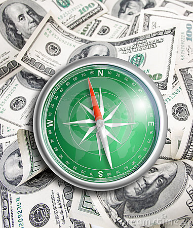 Compass over hundred dollars. Financial concept.