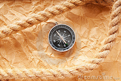 Compass and rope in travel  concept