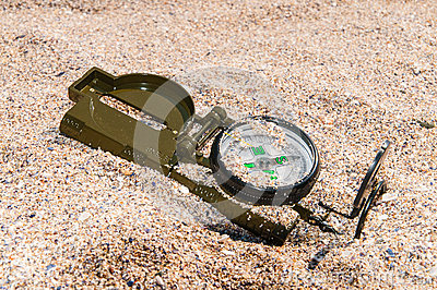 Compass showing a directions on sea sand