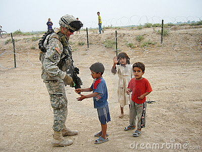 Compassion of a soldier Editorial Photo