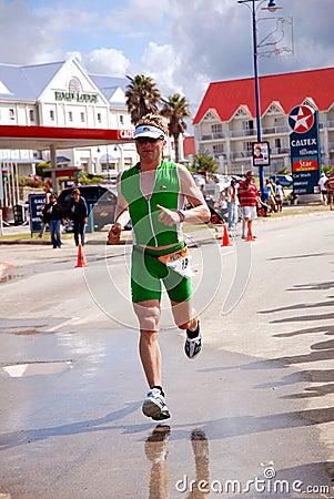 Competing triathlete Editorial Stock Photo