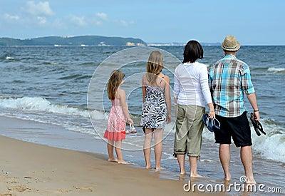 Complete family enjoying sea landscape