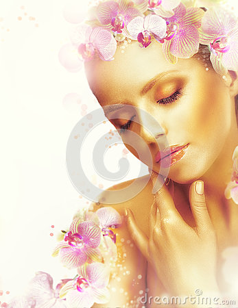 Complexion. Gorgeous Woman with Perfect Bronzed Skin and Orchid Flowers. Fragrance