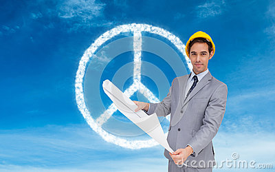 Composite image of architect with hard hat holding plans