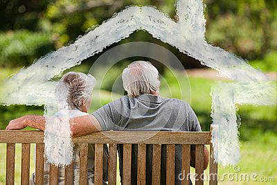 Composite image of couple sitting on the bench with their back to the camera