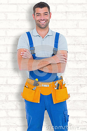 Free Composite Image Of Repairman In Overalls Wearing Tool Belt Standing Arms Crossed Stock Photography - 52548082