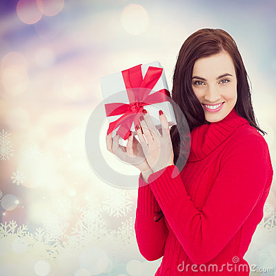 Free Composite Image Of Smiling Brunette In Red Jumper Hat Showing A Gift Royalty Free Stock Image - 62288656