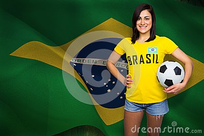 Composite image of pretty football fan in brasil tshirt