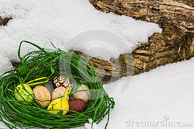 Painted Easter eggs in the snow