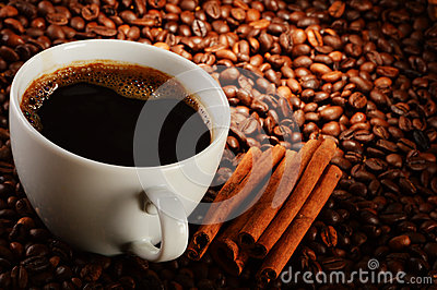 Composition with cup of coffee and beans