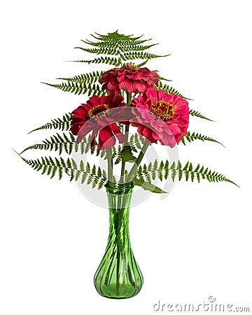 Composition florale avec des fougères et des Zinnias