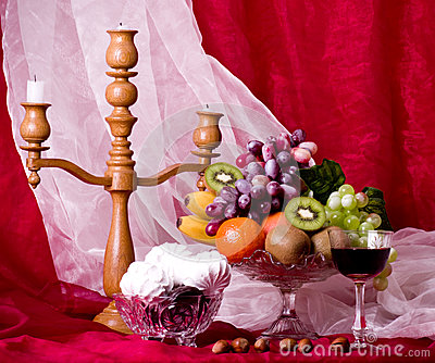 Composition with fruits, candlestick and wine