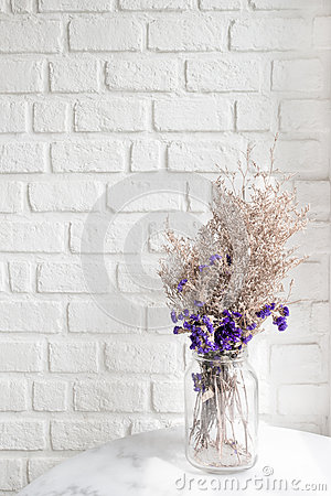 Free Composition Of Dried Flowers On White Wall Brick In Background Royalty Free Stock Image - 61322166