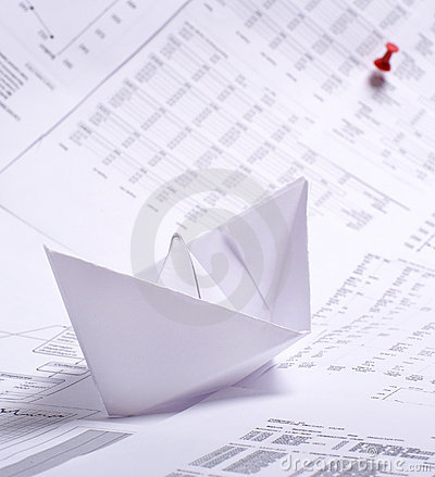A composition of a paper boat and documents
