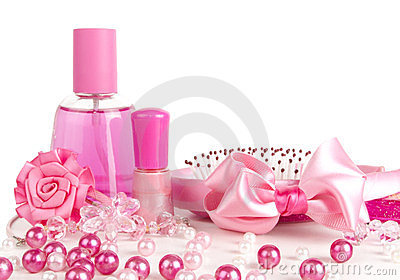 Composition of pink: perfume, a comb, ribbon