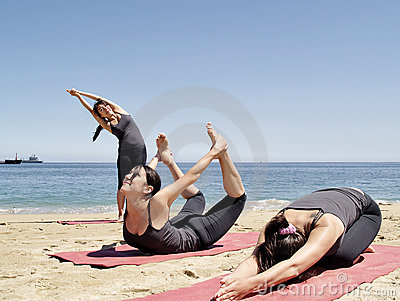 Composition of several bikram yoga poses at beach