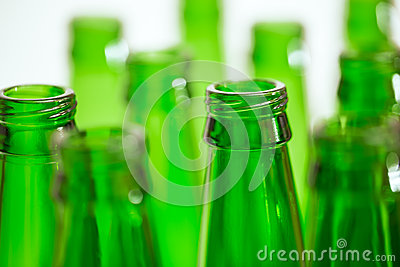 Composition with ten green beer bottles