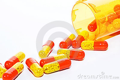 Comprimidos que derramam fora de um frasco