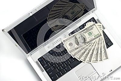 Computadora portátil y dinero