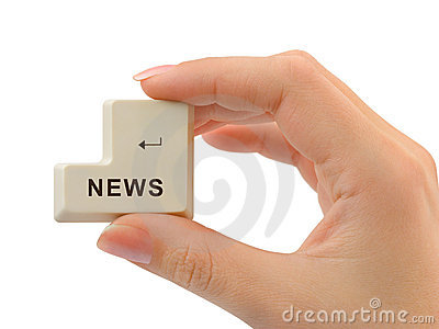 Computer button News in hand