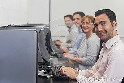 Computer class sitting in front of computers