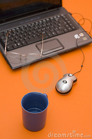 Computer with Eyeglasses and Cup